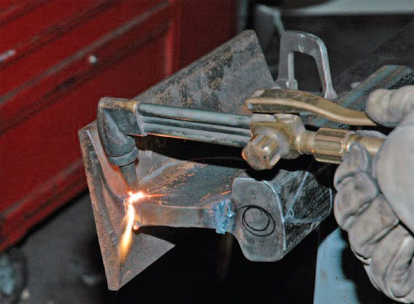 Oxy-acetylene is still a popular method for cutting large chunks of steel. Plasma cutting is fast overtaking it as the price of basic plasma cutters comes down.