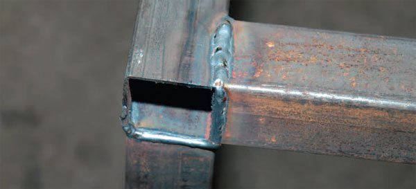 The open end at a corner and the completed welds joining the part to the rest of the structure. You can see the good penetration through the material.