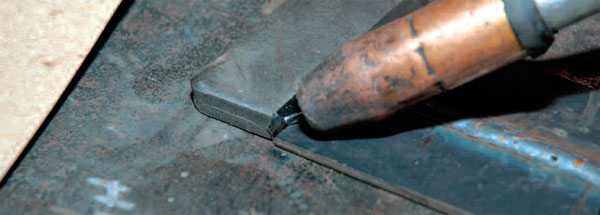 As you prepare to weld the thinner material to the thicker, be sure to start your arc on the heavier piece. Your goal is to melt the thicker part into the thinner one. If you start on the thinner piece, there's less material to puddle and join up.