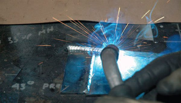 As you weld, wave the welding tip in small motions to melt the thicker piece into the thinner piece. Be careful not to blow a hole through the thinner piece.