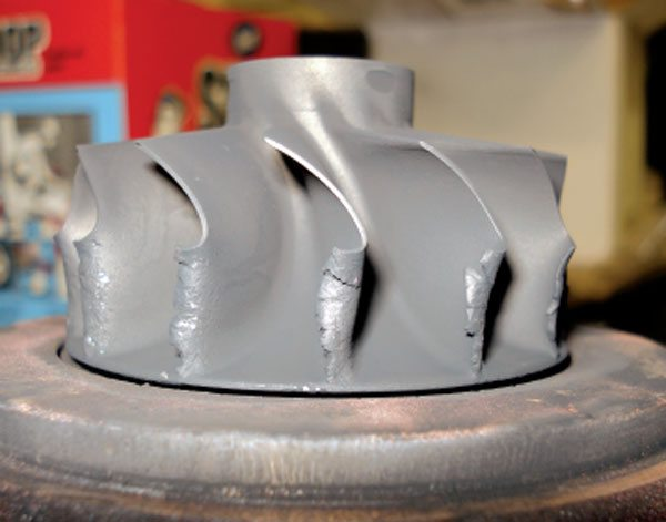 Note how turbine blades are worn evenly around the entire wheel and the turbine wheel material is bent from impact traumas. (Courtesy Honeywell Turbo Technologies)
