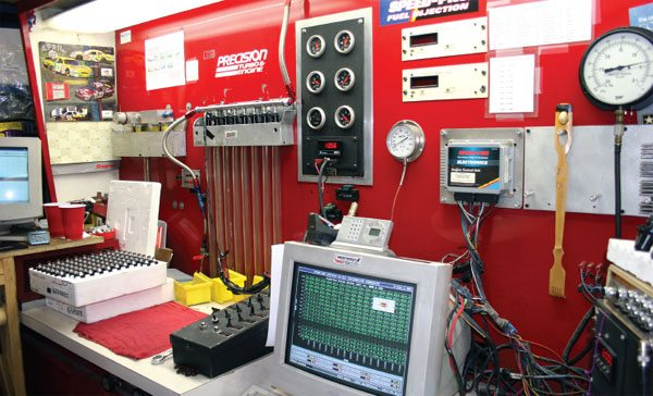 This is a fuel injector flow bench at Precision Turbo and Engine, Hebron, Indiana. The guys use this bench to verify flow to within 1 percent and sell injectors in matched sets.