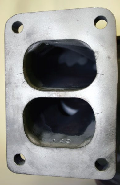 It's quite common that when a turbine-side failure has occurred due to high temperatures, the turbine housing will also show signs of heat fatigue. These include erosion at the inlet and stress cracks from thermal cycles beyond the material's design limits. (Courtesy Honeywell Turbo Technologies)