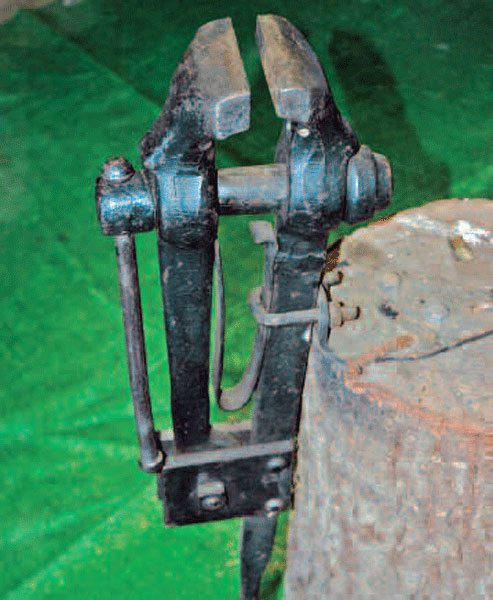 A blacksmith's leg vise is great if you can find one. You can hammer on this tool like an anvil without damaging the screw mechanism.