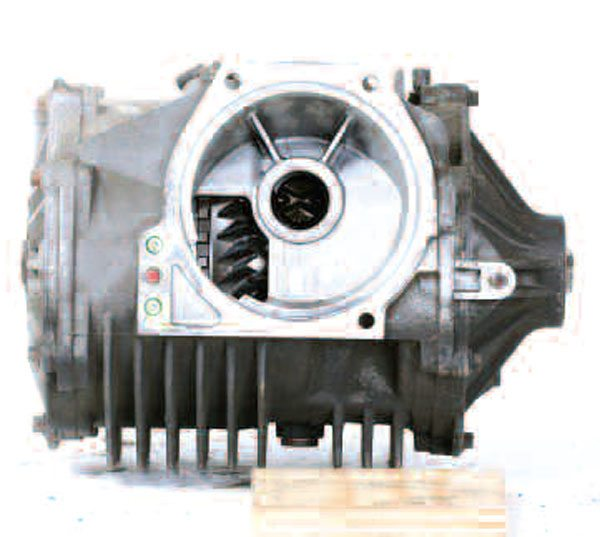 The front surface of a Corvette ICA bolts to the rear mounted transmission. The outputs to the halfshafts are on the right and left. Note the extensive use of cooling fins and the side covers on both sides. There is even a rear cover on this axle. It tends to resemble a square box more than a traditional axle.