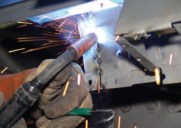 1) In the last 35 years, MIG welding has revolutionized how we join autobody metal. It is fast and efficient, and it provides good quality joints. Oh, that little screwdriver between the fingers of the welder's left hand; read on, and find out why he keeps it there.