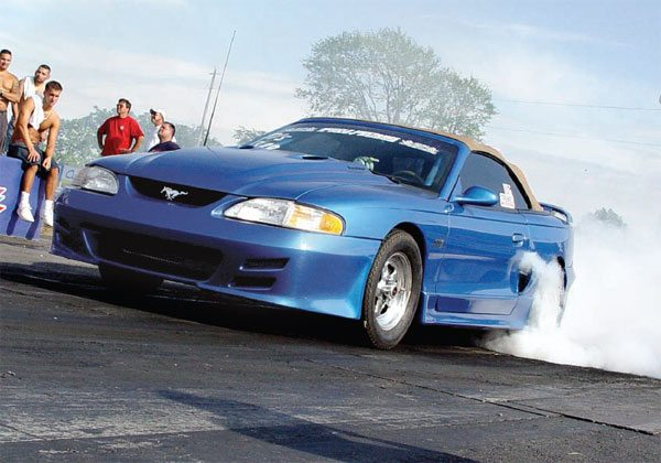 Ready for another routine 9-second run, this Mustang warms the slicks in an attempt to plant all of its power. (Nate Tovey)
