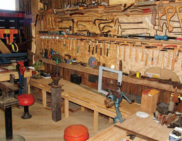 Tools tend to multiply, as if by magic. Most of my hammers, dollies, picks, pries, files, and other bodywork hand tools, are mounted on this wall. My wife thinks it's excessive and, truth be told, I could get by with about 20 percent of them.