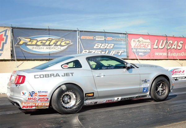 This new Cobra Jet is only moving forward. The front tires are tippy-toeing on the pavement, with just enough raise in the front end to load the rear tires heavily. The rear slicks are biting for all they're worth. This is a great launch with no wasted momentum.