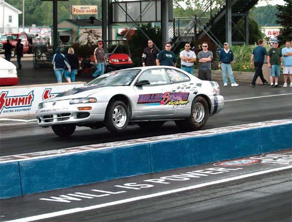 This car definitely needs an anti-roll bar to get rid of the body roll. This much body roll will plant the passenger-side rear tires harder than the driver's side tires, resulting in a crooked launch and a 60-foot time not what it should be. Depending on how rigid the roll cage is, that much body roll could also damage some body panels and glass.
