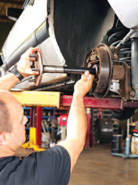 1)As you remove the axle shafts from the housing, it is always a good idea to support them with two hands. This stops the spline end from falling in the axle tube and dragging across the tube, wheel bearing, and seal. The seals will be replaced as a matter of course. (Randall Shafer)