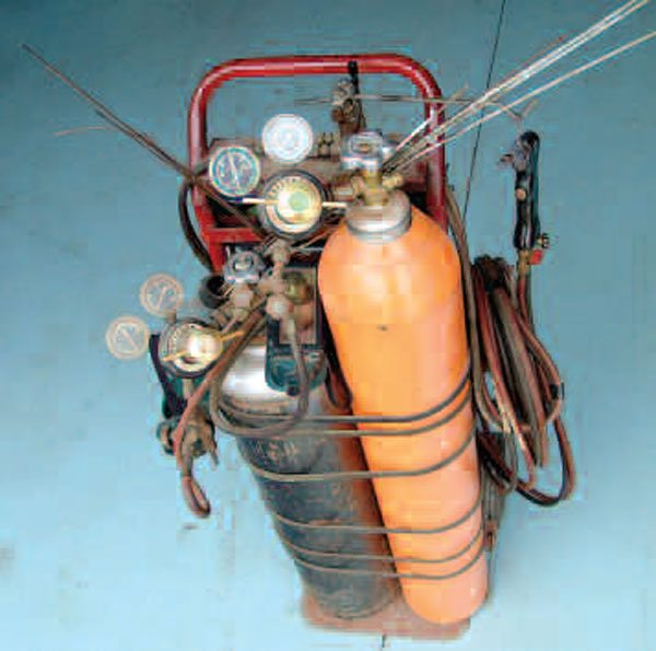 As you advance in this work, you find that you need a good oxy-acetylene torch setup. No other source of high heat, like propane or oxy-propane, has the versatility of oxy-acetylene. While you can weld panel metal with oxy-acetylene, there are better ways to do it.