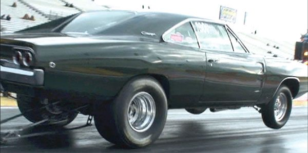 This 1968 Charger got a good bite at the initial hit of the throttle enough to pull the front tires off the ground. However, it then went into tire spin. Time for some tuning. This pass won't be optimal, and it'll show up on his time slip from the 60-foot time to the final quarter-mile elapsed time.