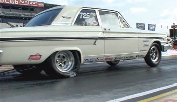 This early Fairlane has a solid bite on the track. The front wheels are up a bit, and the slick is being pushed down and loaded up. You know this was a good pass.