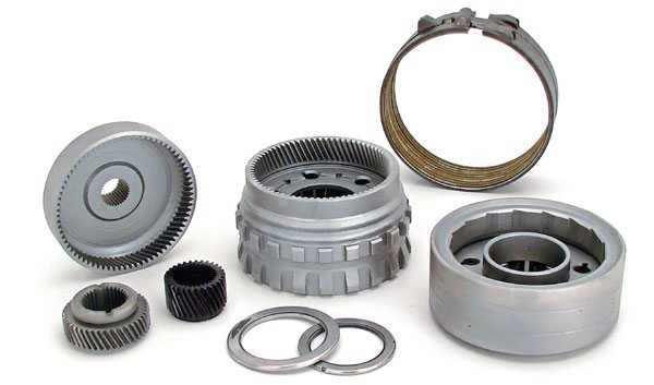 The key to making an automatic transmission live in a heavy car with a lot of power lies in fortifying it with beefy internal components (such as these TCI goodies, including a six-pinion planetary set and additional clutches) and keeping the transmission fluid cool.