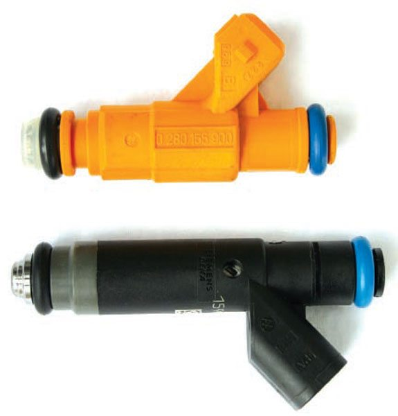 Injectors from different manufacturers shown side by side. The general construction and design is the same despite different lengths and internal flow rates. (Nate Tovey)