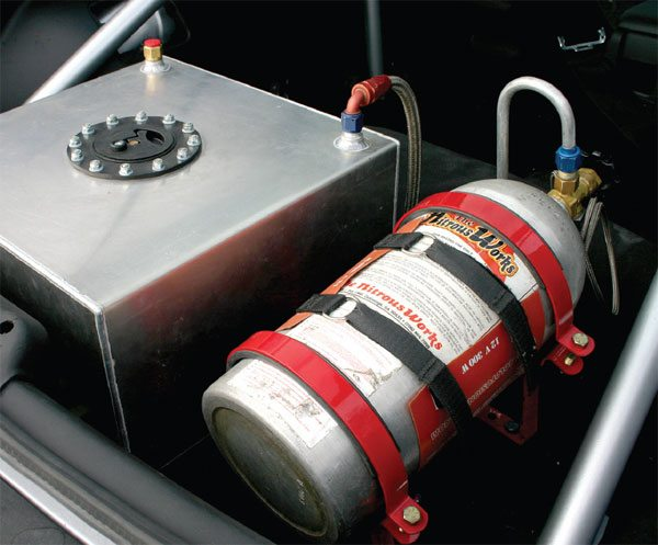 Nitrous oxide gas is stored in high-pressure tanks usually mounted in the trunk of the vehicle. To ensure proper performance, a heater is sometimes used to maintain a consistent feed pressure to the solenoids as the bottle is drained.(Nate Tovey)