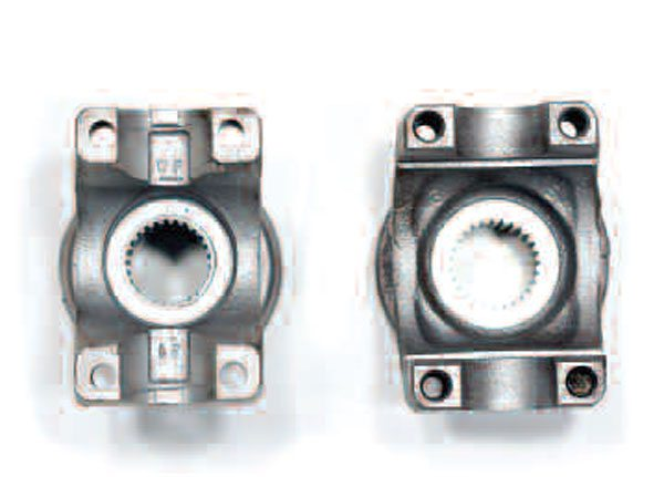 A careful comparison of the U-bolt-style and strap-style half-round attachment yokes reveals that the U-bolt style on the left has through  holes. The strap style has tapped holes. This U-bolt-style yoke uses tabs on the yoke while this strap-style yoke requires internal snap rings.
