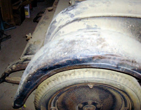 This fender was damaged by collision and by crude attempts to hammer out its damage. Now, there is a range of approaches to repairing it, from dealing with its stretched and deformed metal to removing the worst of it and sectioning in new metal.
