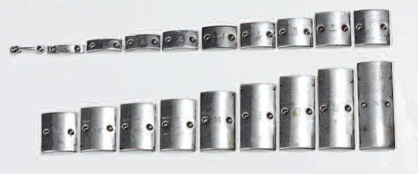 These are the typical, precision, weld-on-style balance weights for a steel propshaft. The weights range from 1 gram (upper left) to 24 grams (lower right). These perform the same function as the balance weights on your wheels, but are welded in place and are not servicable.