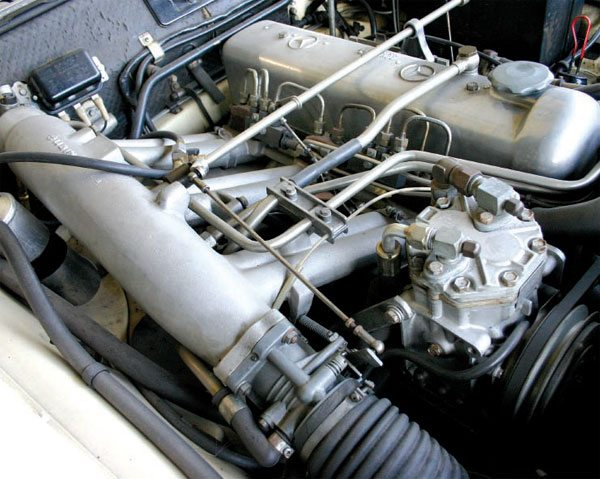 The engine in this Mercedes 220SE is equipped with mechanical fuel injection and makes about 120 hp from 2.2 liters. It has limited capability to adjust for changing weather conditions. (Nate Tovey)
