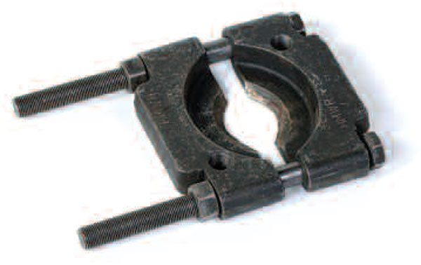Place this type of bearing removal tool around the back side of the bearing race, and tighten the two halves together. Pull just on the race and not the roller or cage. This tool works well when you can get behind the bearing race. (Randall Shafer)