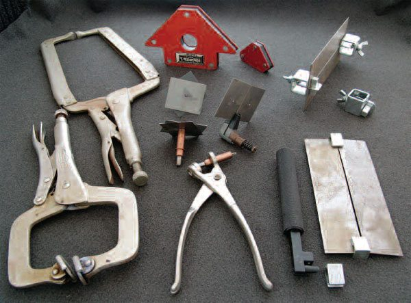 Some common fixturing tools are shown holding small metal pieces. Left: locking pliers. Center top: magnets. Center bottom: standard Clecos (left) with both sides shown, and Cleco edge type clamp (right). Install tool is below them. Right top: thumb clamps. Right bottom: pressure-type edge clamps and install tool.