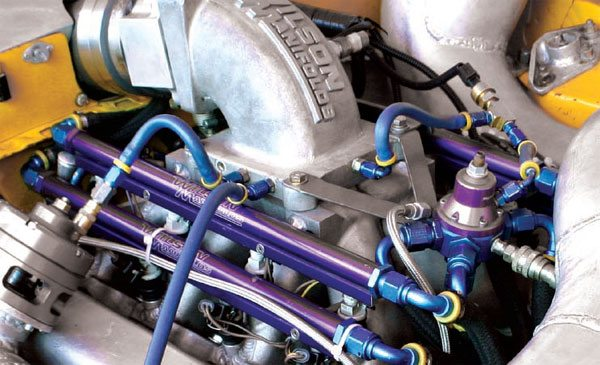 This Super Street Outlaw engine uses two sets of injectors, each on its own rail, to supply enough fuel to make almost 2,000 hp. With an EFI control system, changes in weather are automatically compensated for by the PCM to keep the engine running at its peak. (Nate Tovey)