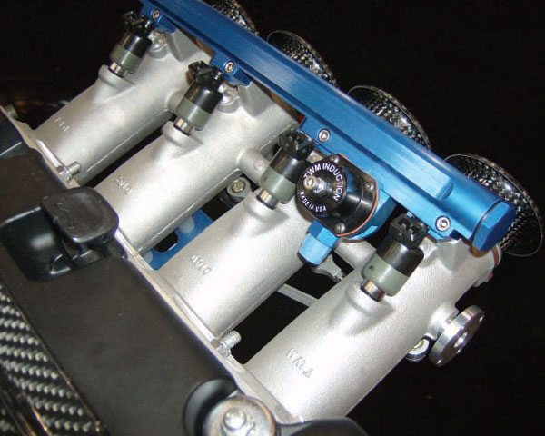 """With individual throttle bodies and essentially unlimited plenum volume, """"stack"""" EFI systems like this one usually work best in alpha-N mode with a standalone PCM."""