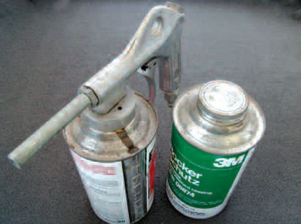 Hot paraffin-based rust-poofing material is great for protecting most undercarriage surfaces, where the impact of gravel and stones is not a problem. Where it is, a good rubberized undercoating works best. The coatings shown here are applied with the air sputter gun, shown in the can on the left.