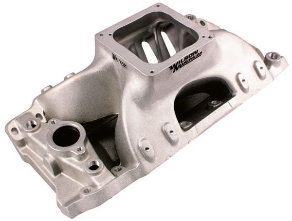 Most as-cast intake manifolds can be improved by specialized porting services like Wilson Manifolds. Most service providers excel at matching intake manifolds to your cylinder heads to achieve the proper turn-ins at the port interface and at the most desirable blending and port surface texturing.
