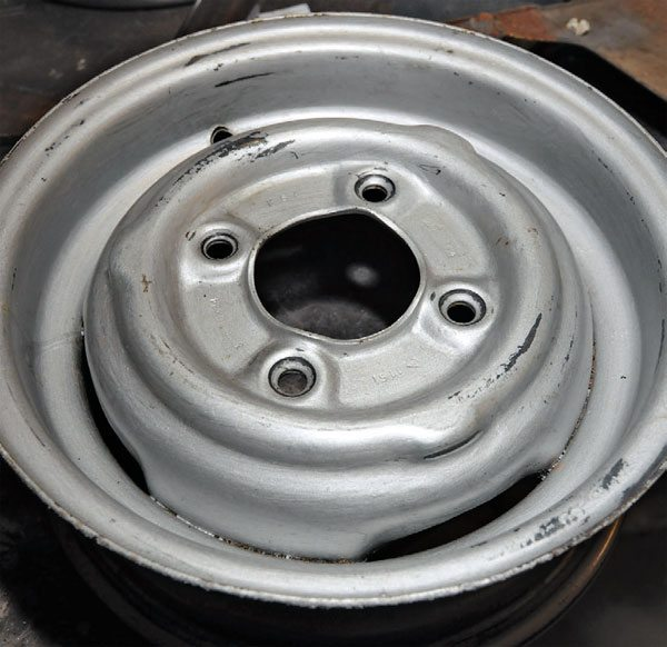 This wheel from a vintage Mini Cooper was the main project for a media blaster outfitted with glass beads. The beads are small (like sand grains); this wheel has some dirt, but mainly a couple coats of old spray paint on it. I could have used some stripper, but this is a good blasting test.