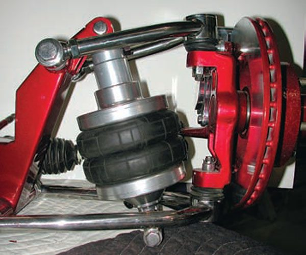Air bags (maybe they're more accurately called air springs) are very popular these days. This Shockwave unit combines the air bag and an adjustable shock in much the same way a coil-over combines a steel spring and a shock absorber. (Photo Courtesy RideTech)