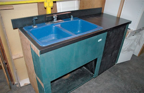 If you have plumbing in your shop, consider installing a used sink. You can usually find them for free or for a very small price on craigslist or at a ReStore. Just be careful not to flush hazardous chemicals into the sewer system.