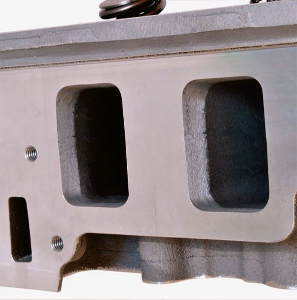 SuperMod ported, spread-port big-block Dart head illustrates basic port matching in the first 1/2 inch of the intake ports. Ports remain as cast, but chambers are fully CNC'd to encour¬age combustion efficiency.