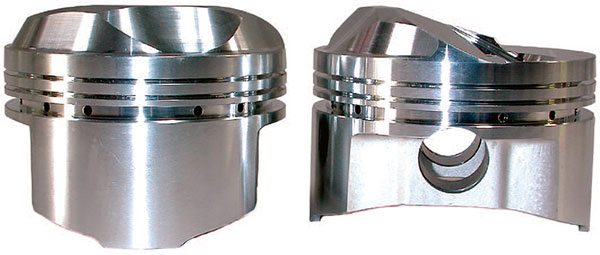 Extra-tall domed pistons are still required for certain applications with large combustion chambers in order to achieve higher compression ratios. These pistons require close attention to detail regarding valve-to-piston clear¬ance, valve shrouding, and a generous fire slot to ensure efficient flame travel.