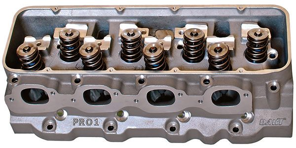 Highly refined canted-valve aluminum cylinder heads such as this Pro 1 head from Dart represent the gold standard in commercially available racing cylinder heads. Available in varying degrees of preparation they can be further finished to any degree of precision necessary to meet specific racing requirements.