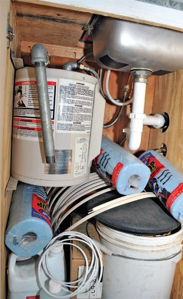 A small water heater can heat enough water to fill your bucket without running up the electrical power bill in your workshop. Some models fit under a standard counter.