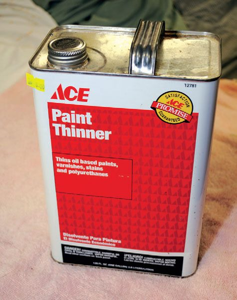 Plain old paint thinner works well for getting rid of many paints and coatings. Be sure to leave it in the can and use it in a well-ventilated environment, as it quickly evaporates into fumes.