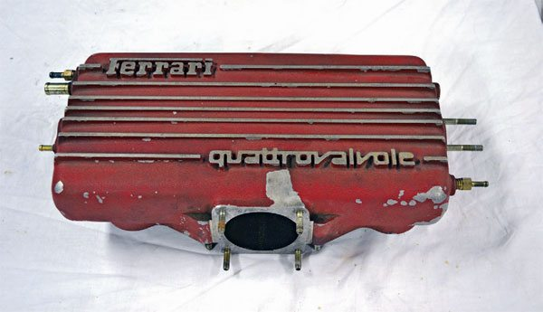 This intake plenum from a Ferrari 308 was in dire need of refinishing. Subjected to heat and grime, even in a Ferrari engine bay, the original paint is long-since cooked and darkened.