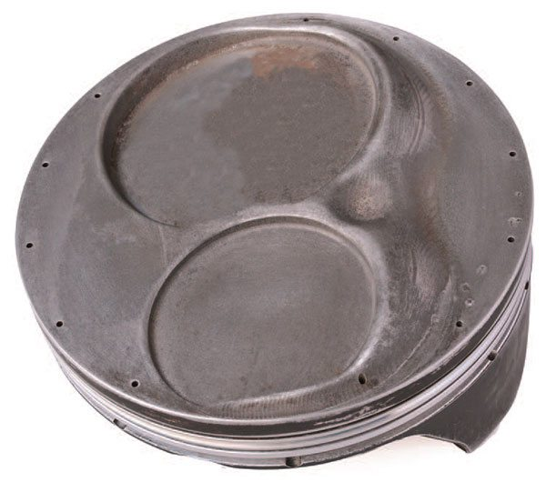 Advanced piston coatings have be¬come the norm in many racing circles. This piston features a thermal heat barrier on the crown and a friction-reduction coating on the skirts.