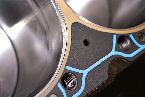 Most builders have a favor¬ite gasket for the engines they build. This Fel Pro head gasket illustrates how the gasket bore is typically larger than the cylinder bore with an irregular shape around the valves.