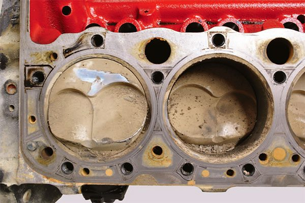 Here's the same El Mirage dry lakes roadster engine after a 175- mph spin in the dirt. The car snap spun so quickly the driver had no time to close the throttle, hence the immediate unavoidable trans¬fer of assorted lakebed material to all cylinders.