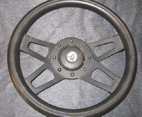 "There are some awesome steering wheels on the market today, but you don't have to spend a fortune on one. I bought this old 13-inch-diameter Grant ""Challenger"" wheel at a junk-yard for $5 about 25 years ago. It's been in my hands when I've done some of the stupidest things I've ever done in a car . . . and we're both still here. I wouldn't sell it for $1,000."