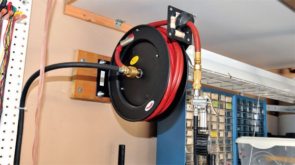 A hose reel like this one costs about $40, and makes a neat and convenient storage system for your air hose. Plus, it looks professional.