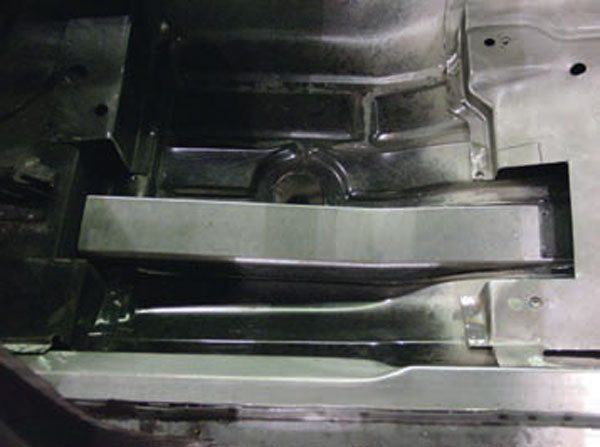 An interior shot of Camaro weld-in subframe connectors prior to welding. The floor has been notched to give more ground clearance and tie the connectors into the body structure for more overall rigidity. Solid aluminum subframe bushings are also recommended. (Photo Courtesy Detroit Speed and Engineering)