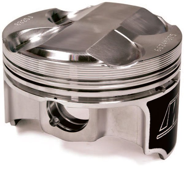 An exception to the flat-top revolution is this Honda S2000 piston designed for a pent-roof combustion chamber in the Honda four-valve-per-cylinder head.