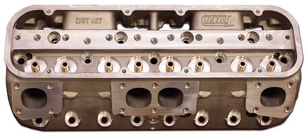 Dart's 9-degree aluminum small-block Chevy race head illustrates the ideal simplicity of an inline-valve configuration with optimum port placement and compact 38-cc combustion chambers to achieve superior power potential.