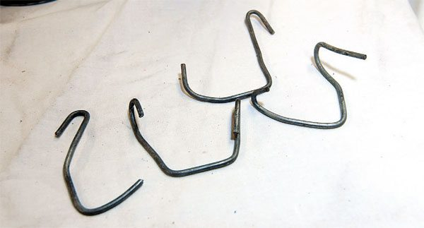 Make some S-hooks of different sizes and shapes out of wire fence clips or an old coat hanger. These are handy for hanging your work when you're spraying powder coat, or for hanging your work in the curing oven. You can attach the hooks to the broiler element or its supports.