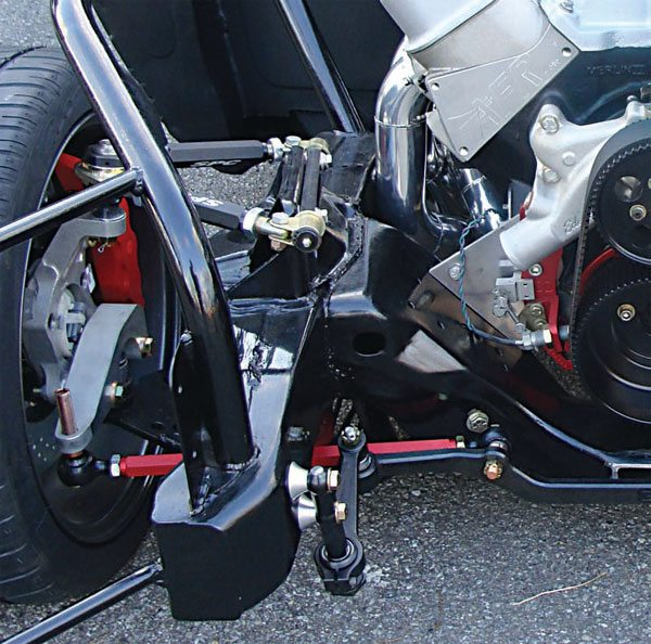A closer look at the front suspension and steering under Johnston's car reveals SPC Performance upper and lower A-arms, AFX aluminum spindles, and many custom parts. Note the Howe Quickbump tie-rod ends, which allow fine adjustment of the bump steer. (Photo Courtesy Steve Johnston)